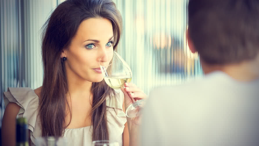 girl drinking her wine and watching her guy