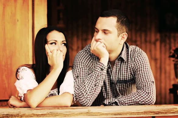 Young-thinking-couple-looking-at-each-other