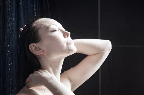 Attractive Mixed Female Taking a Shower looking up enjoying